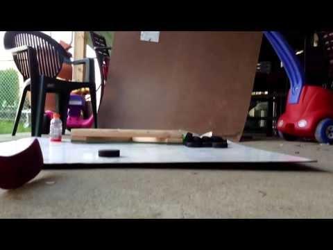 Homemade hockey shooting pad and puck rebounder