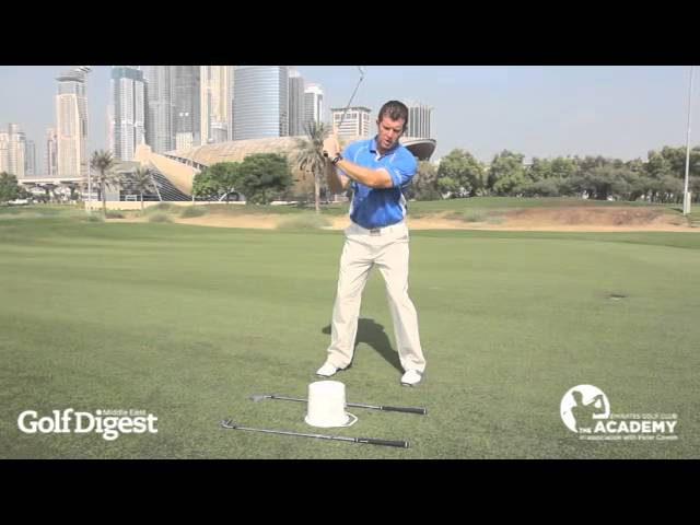 Improve your golf swing with Pete Cowen's Axe Drill