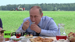 Russia: Putin tries local produce after inspecting farm in Tver Oblast