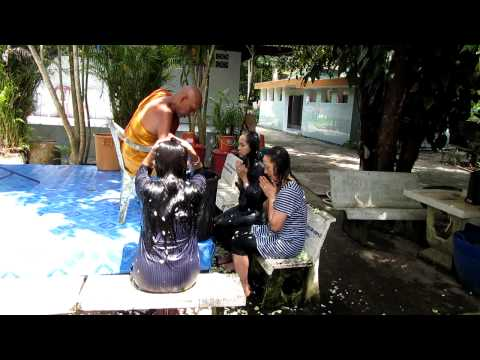 Three beautiful Thai Girls completely soaked by monk in Buddhist water blessing - Thailand - 720p HD