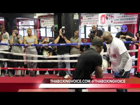 ADRIEN BRONER AND TRAINER MIKE STAFFORD DOING MITT WORK
