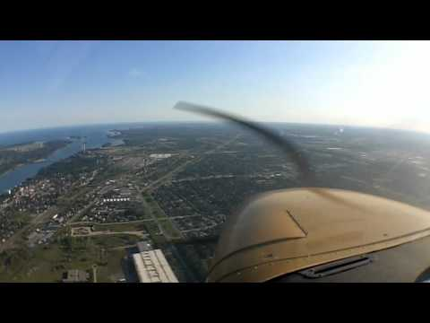 A nice summer evening flight from Detroit, MI down the Detroit River and past the city, all the way to Waynesville, OH. I captured a bunch of ATC/FSS communications as well as the first PIREP...