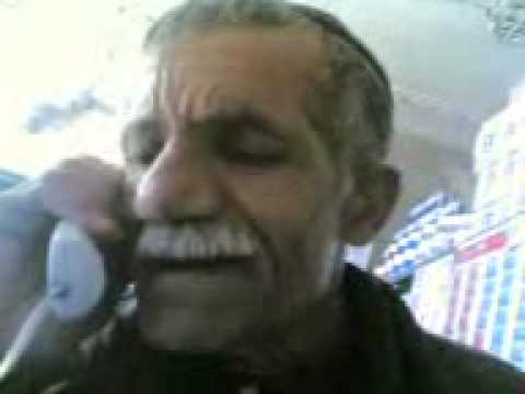 old man talking in Kurdish and Farsi on the phone