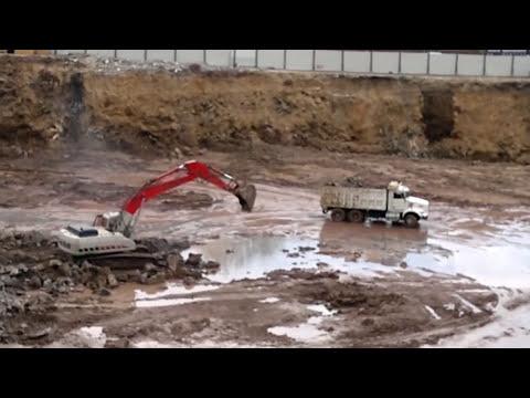 link belt excavadoras y tractocamiones nivelación de terreno