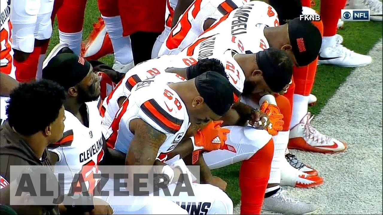 Trump's sports row: NFL players react across US