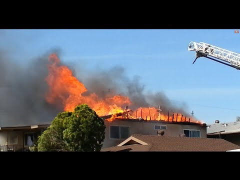 Firefighters Hose Down Intense Windy House Fire HD