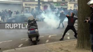 Police use tear gas at protest against police brutality in Paris.