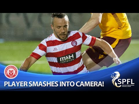 Accies star smashes into camera and comes off worst!