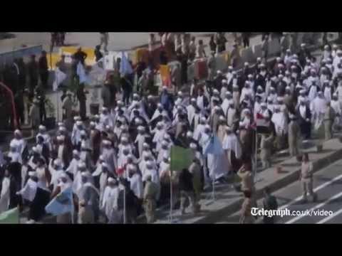 Thousands of Shia militia parade in Baghdad