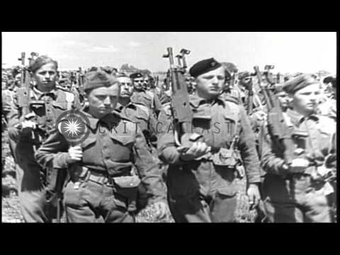 The Yugoslav Partisans dressed in uniforms march during World War II. HD Stock Footage