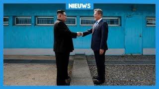 Bijzonder: leiders van Noord- en Zuid-Korea geven elkaar een hand
