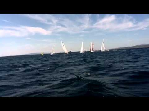 Ufo 22 rolling and surfing in a 20 knots NE breeze
