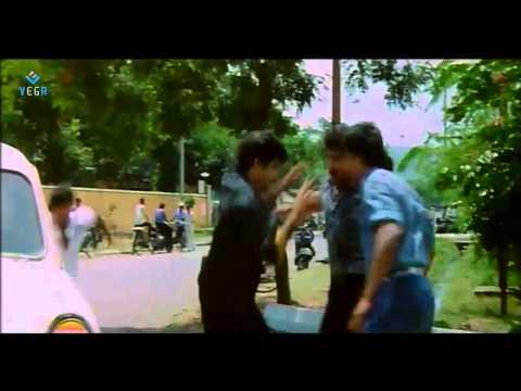 Auto Rani Movie : Balakrishna Saving Nirmalamma Photo Image Pic
