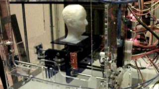 Homemade 3D Printer at work printing a head.