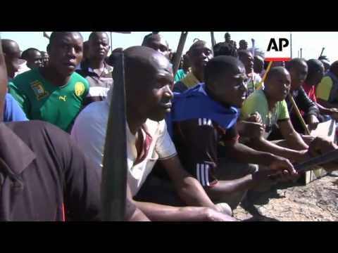 Miners march near troubled Marikana platinum mine, ignoring call to return to work