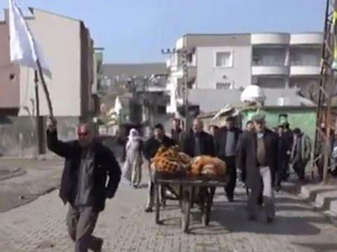 Turkish regime shooting Kurdish civilians waving white flag