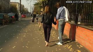 Barefoot Girl Walks in Streets with Her Boyfriend