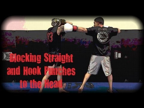 Muay Thai - How to Block Straight and Hook Punches to the Head Image 1