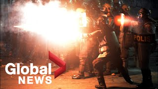 Indonesia riots: Tear gas, fire erupts as protesters clash with police in Jakarta