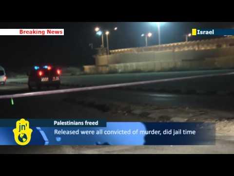 Israel frees 26 Palestinian prisoners convicted of murdering Israelis as part of peace talks deal