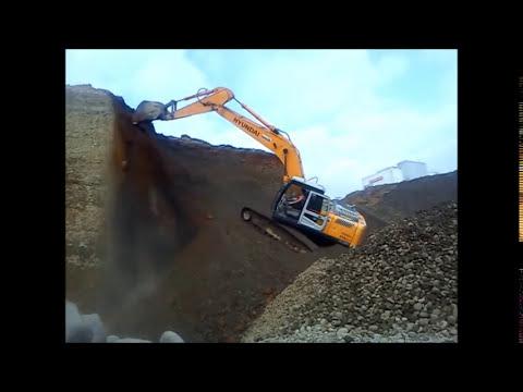 excavadora trabajando hyundai 210