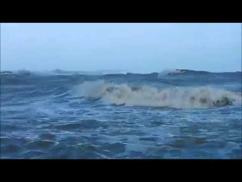 Man swimming in Strong Gale force wind (Ex-hurricane Bertha)