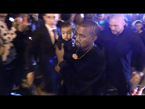 Kim Kardashian, Kanye West and Baby North leaving the Balanciaga Fashion Show in Paris