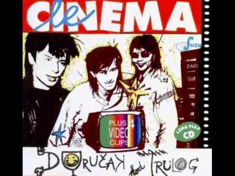 """Le Cinema su Marino Pelaji�, Mladen Juri�i� i Piko Stan�i�. Ovo je njihova obrada stvari ''Ona se budi'' Šarlo Akrobata na albumu iz 2002.godine """"Doru�ak kod Trulog"""""""