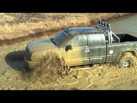 Chevy Silverado 4x4 mudding in the pond