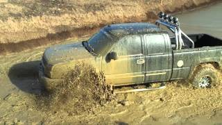 Chevy Silverado 4x4 mudding in the pond
