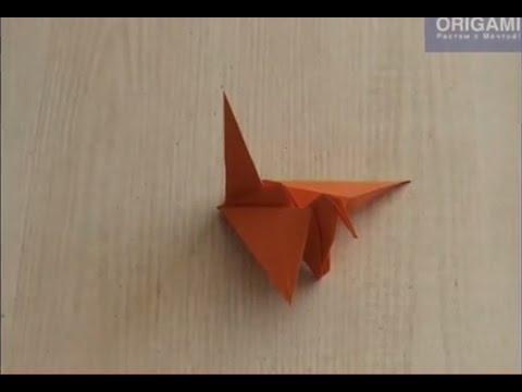 Журавлик оригами, машущий