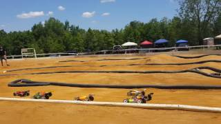 Tommy racing the buggy 1/10 scale .rc at dirt runners