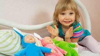 Alena plays with toy rabbits