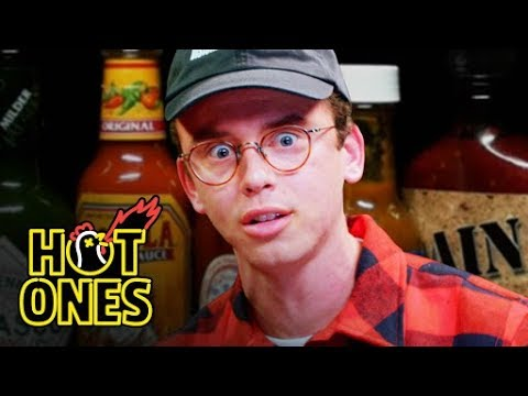 Logic Solves a Rubik's Cube While Eating Spicy Wings | Hot Ones