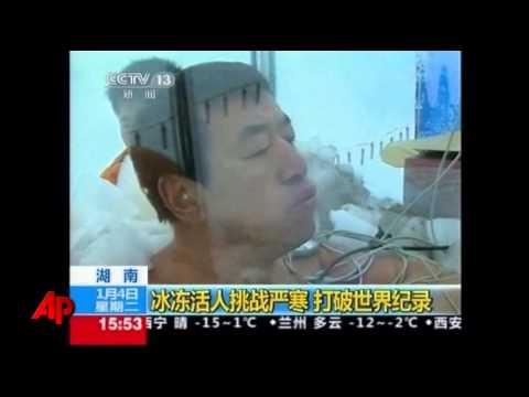 Men Sit in Ice Bath, Melting World Record