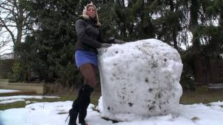 TAMIA IN HIGH HEEL BOOTS BUILDS A SNOWMAN