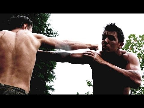 KRAV MAGA TRAINING • How to counterattack Straight Punches Image 1