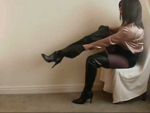 Crossdresser in leather skirt and thigh high boots.