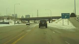 Hauled tractor hits bridge in East Peoria, IL
