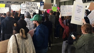 Hundreds protest travel ban at Austin-Bergstrom International Airport | 1/2017