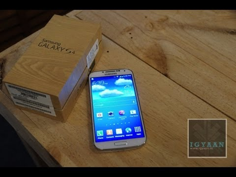 Samsung Galaxy S4 i9500 Unboxing. Setup and Hands on Review - Feat HTC ONE - iGyaan