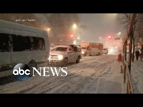 New York-area commuters stranded for hours amid snow