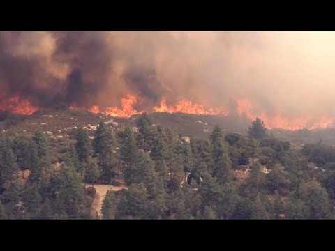 At least 60 wildfires raging in the West