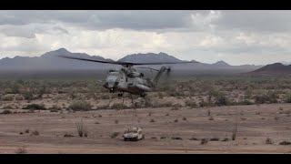 CH-53 Delivers a HUMVEE to Marines