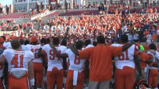 Clemson fans and football team sing the Clemson alma mater after beating NCSU