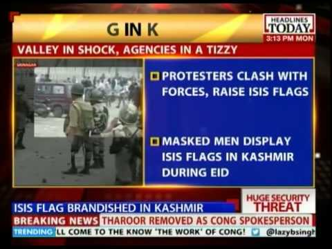 Masked men display ISIS flags in Kashmir during Eid
