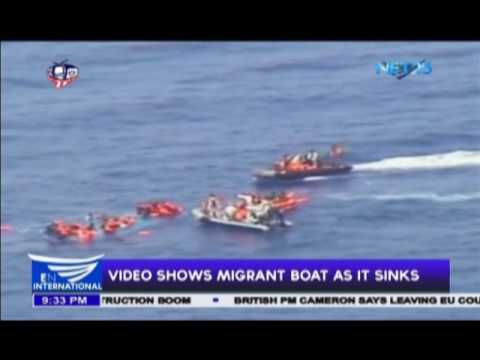 Italian Navy shows migrant boat as it sinks