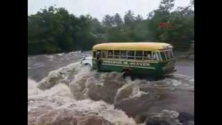 Bus packed with people overturns and washed away by raging river