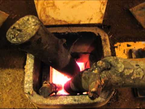 wood stove vs. rocket mass heater