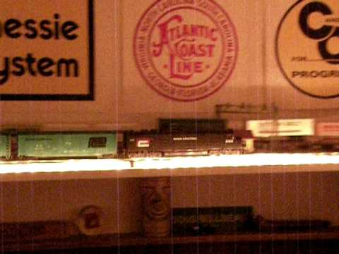 Ceiling shelf model railroad - Penn Central freight train.AVI